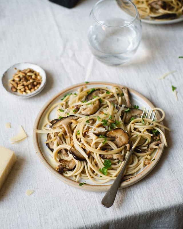 plate of mushroom pasta at table setting