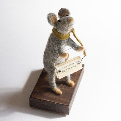 mixed media mouse sculpture needle felted mouse holding a sign saying I believe in cheesus