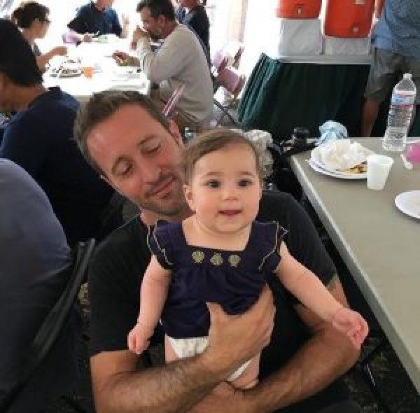 Alex O'Loughlin holding baby