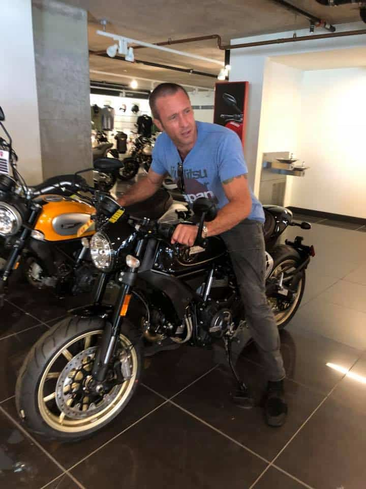 Alex O'Loughlin and motorcycle
