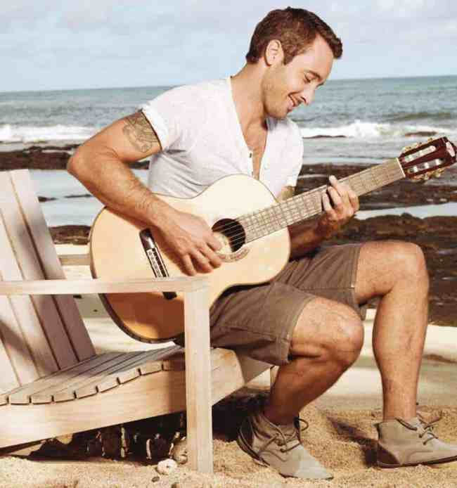 Alex O'Loughlin playing Guitar on Beach