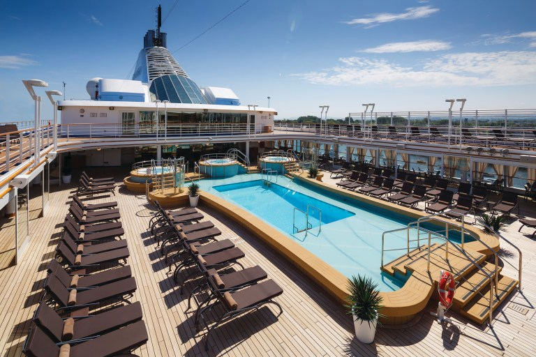 Swimming pool and chaise long waiting for the guest in the Pool Deck, Silver Spirit