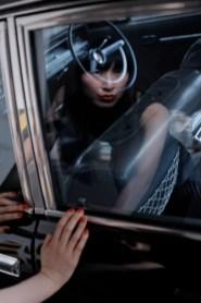 Mari reflected in classic car