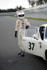 Tetsu Ikuzawa emerges from his car after winning the race