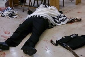 A victim of the Jerusalem synagogue terror attack lies wrapped in a prayer shawl and tefillin. Photo: Twitter.