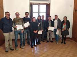 La consellera, Mercedes Garrido, i el cap de servei del Consorci Serra de Tramuntana Patrimoni Mundial, Pep Bernales, amb els premiats