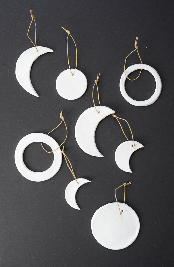 Make these modern DIY moon phase clay ornaments.