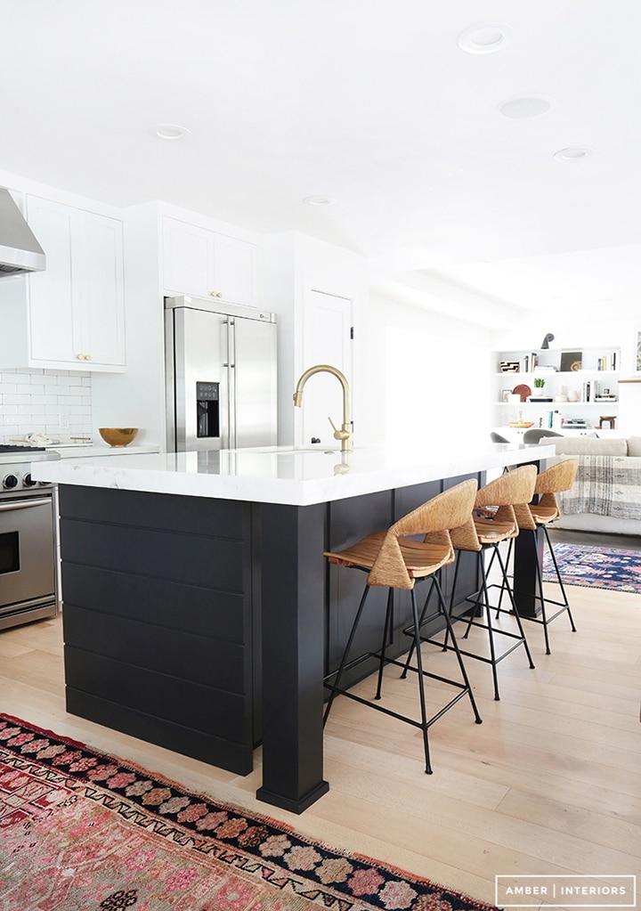 Love the dark island contrast in this kitchen.