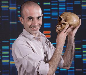 Yuval Noah Harari holds a homo sapiens skull.