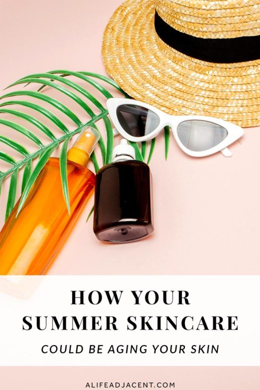 Bottle of sunscreen, sunglasses and straw hat