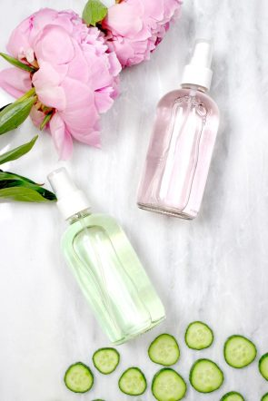 Bottles of DIY makeup setting spray made with rosewater and glycerin