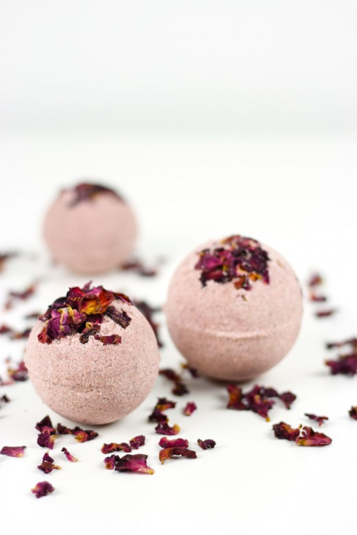 DIY rose petal bath bombs surrounded by rose petals