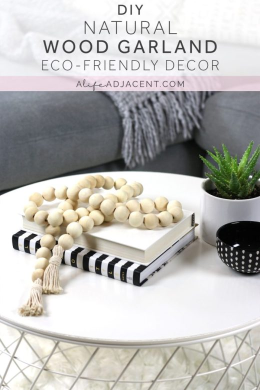 Eco-friendly wood bead garland styled on white coffee table