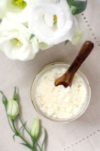 Learn how to make an easy, skin-revitalizing DIY rosemary peppermint sugar scrub with Japanese camellia oil. Rosemary and peppermint essential oils increase circulation, reduce stress, and help alleviate muscle aches and pains. Camellia oil is light, non-greasy, and nourishing to the skin. It's also higher in quality than oils such as sunflower and sweet almond. #DIY #DIYBeauty #GreenBeauty