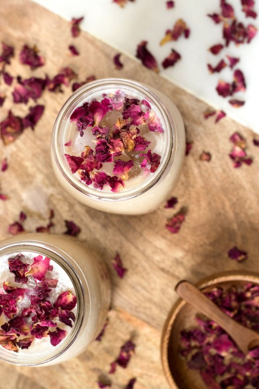 Maple iced latte with edible rose petals as garnish