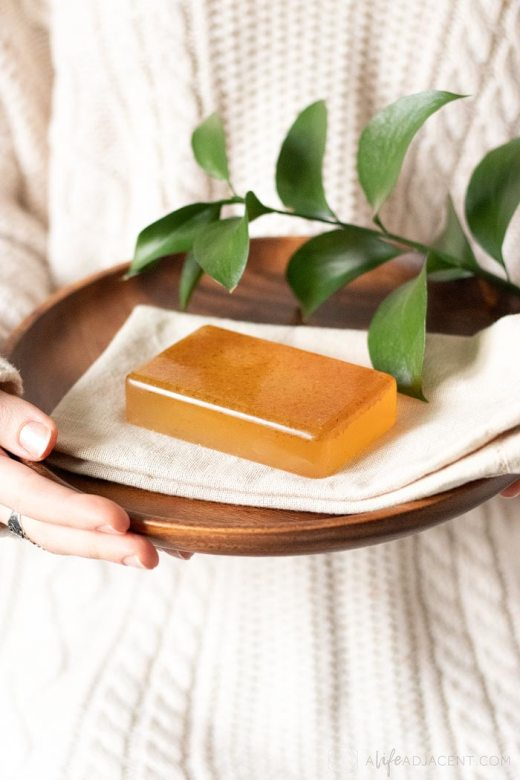 DIY honey almond soap on wood plate