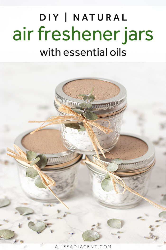 If you've ever opened your closets or clothing drawers to a less than pleasant scent, you will love these simple and natural DIY air freshener jars! Place one in your bathroom, car, closet, shoe cabinet or any other space in your home that's prone to odors. Inexpensive and easy to make with baking soda and essential oils. Dried lavender buds, raffia ribbon and a sprig of eucalyptus add a touch of beauty. #alifeadjacent #essentialoils #homehacks