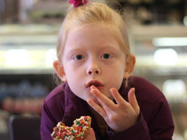 Child eating a donut
