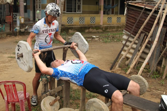 Thai helping Jack lift some weights. Ever the entrepreneur, Thai makes custom Vietnam bike jerseys like these that he sells to eager clients - talk about a great souvenir.