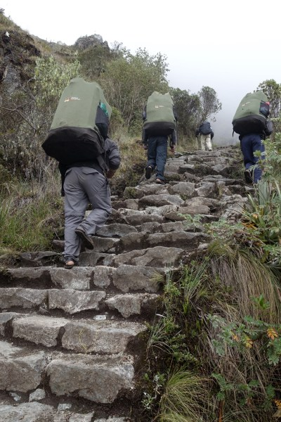 Several of our porters, carrying our food, tents, clothing on the Inca Trail.