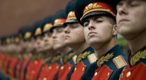 Line of russian army men dressed smartly standing in drill competition