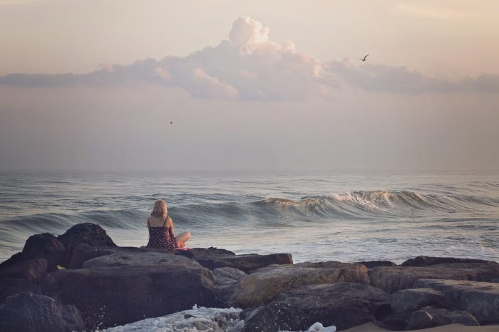 woman-staring-out-to-sea