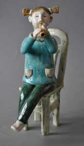 figurative-ceramics - 6a.The-girl-playing-a-pipe.-h-18.