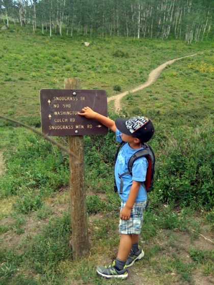 """kid on hiking trail"" ""snodgrass trail sign"""