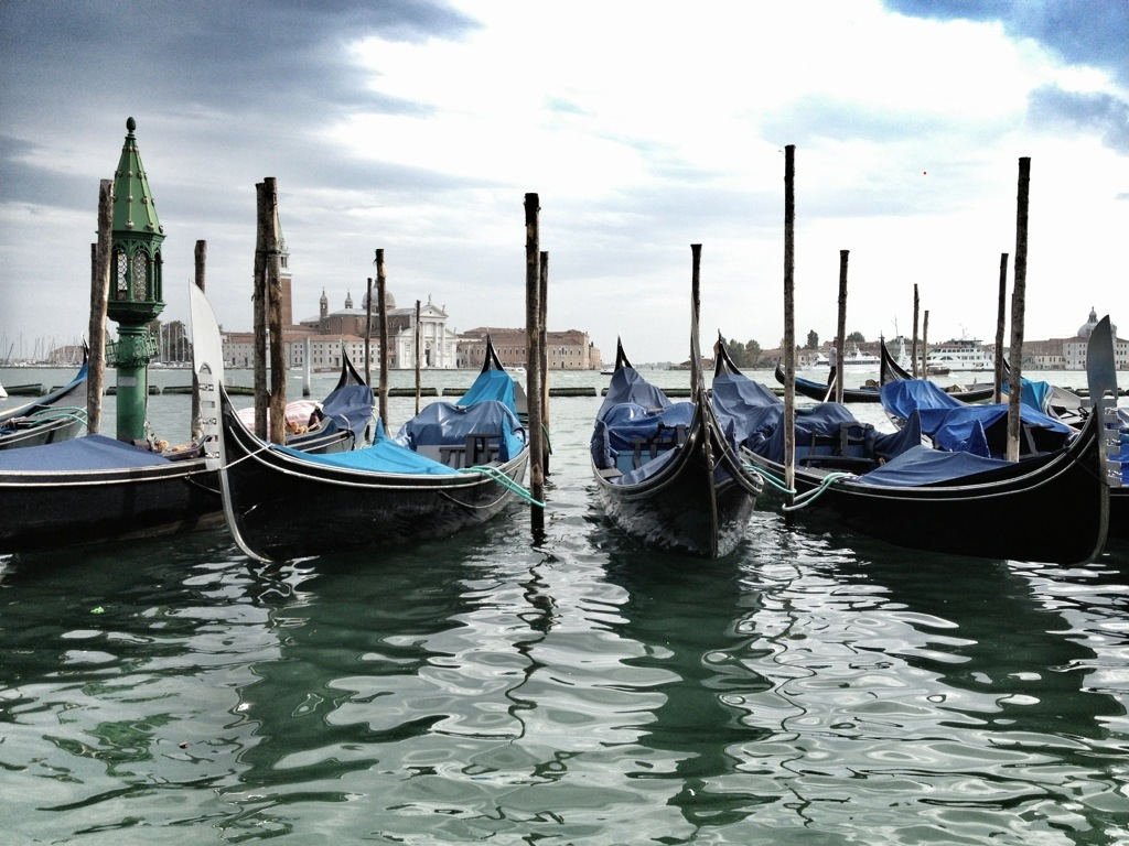 Gondolas waiting on the Grand Canal in Venice, Italy