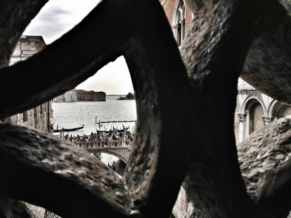 Peeking out from the Bridge of Sighs in Venice, Italy