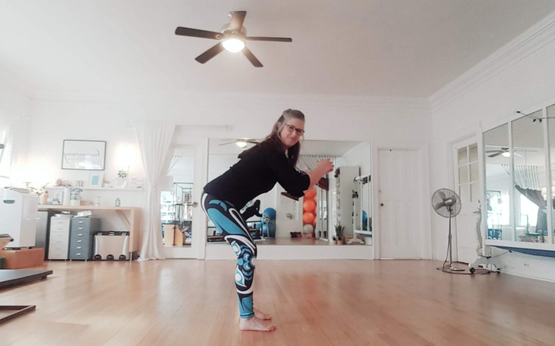 woman doing a high squat