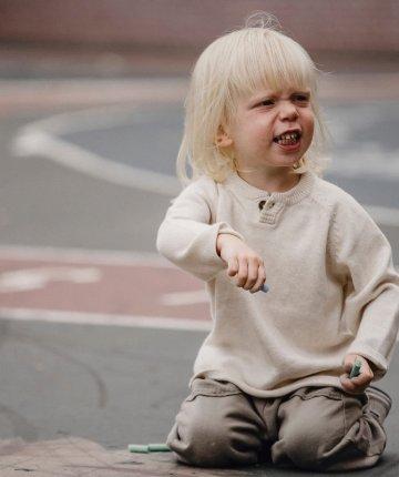 upset toddler on sidewalk