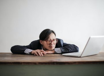 bored man at desk