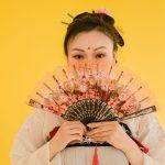 asian woman holding fan