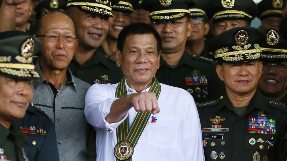 Image result for duterte, with military leaders, fist out, photos