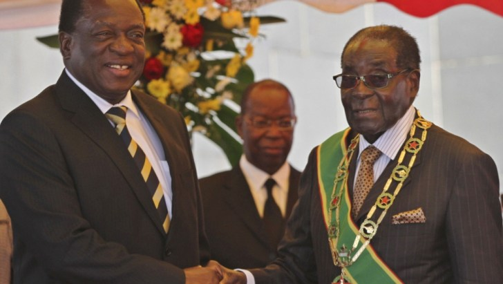 President Mugabe greets Vice President Mnangagwa as he arrives for Zimbabwe's Heroes Day commemorations in Harare