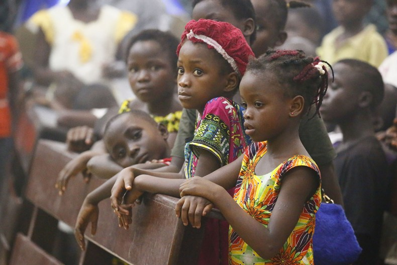 Liberian children attend a special prayer service to celebrate the new year at the Sacred Heart Cathedral Church in Monrovia, Liberia. [Ahmed Jallanzo/EFE/EPA]