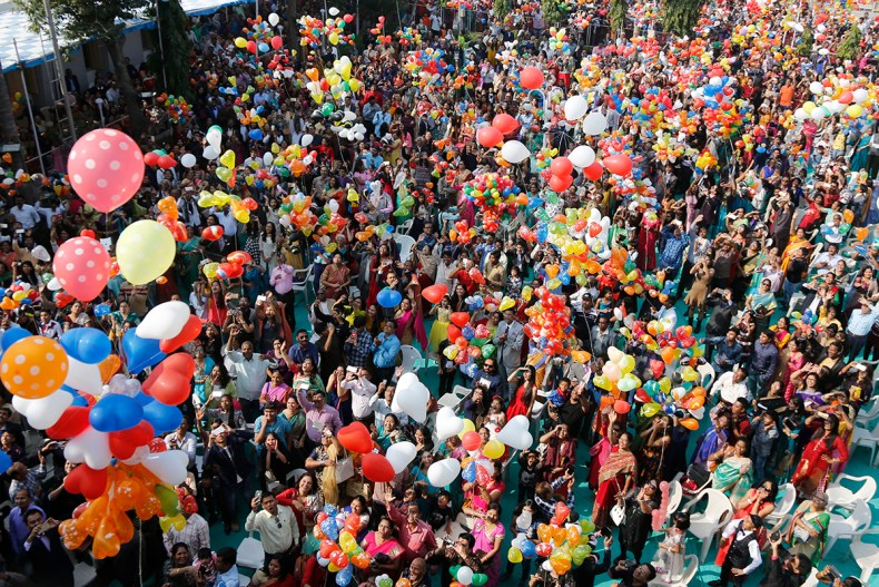 Indian Christians release balloons to celebrate the new year after offering prayers at a church in Ahmadabad, India. [Ajit Solanki/AP Photo]