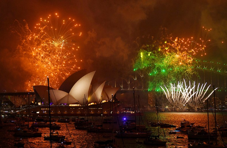 Fireworks explode over Sydney Harbour during New Year's Eve celebrations in Sydney, Australia. [David Moir/AAP Image/AP Photo]