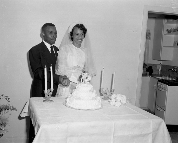 A bride and groom cutting their wedding cake in 1952. The shared desire of civil rights leaders and organisations to repeal Jim Crow laws was often met with violence and intimidation by local officials and mobs, the photographed images of which dominated media coverage at the time. But all the while away from the marches and protests another side to Black life continued out of the gaze of mainstream America. [Calvin Littlejohn; Calvin Littlejohn Photographic Archive, Briscoe Center for American History]