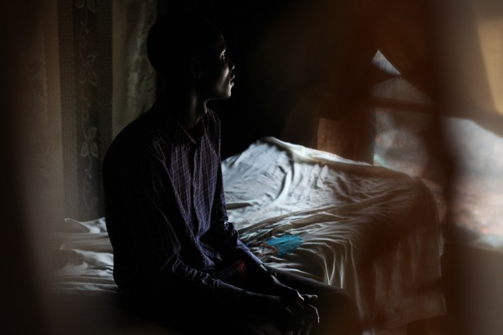 Y, 18, in his home in the POC in Juba, where he has been living since January 2018. He was going to school in Malakal when the war started. He fled to a village in Fangak where his family is originally from. 'When the enemy attacked us, I decided to join because I was angry. They killed old people, children, disabled people who could not escape. One of my cousins was killed. I knew that if they reach our village, they would kill my family, destroy our properties. I thought, it's better if I die fighting them then let them kill my parents.' At the beginning of this year, he asked to go to Juba. 'I didn't want to be there any more. The soldiers on both sides, it's not them, they could shake hands. But the big people make them fight.' [Andreea Campeanu/Al Jazeera]