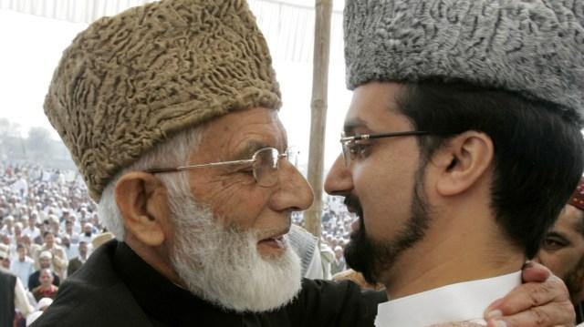 Mirwaiz Umar Farooq, (R) Chairman of Kashmir's moderate faction of All Parties Hurriyat (Freedom) Conference (APHC), and Syed Ali Shah Geelani Chairman of the hardliner faction of APHC hug on the occ