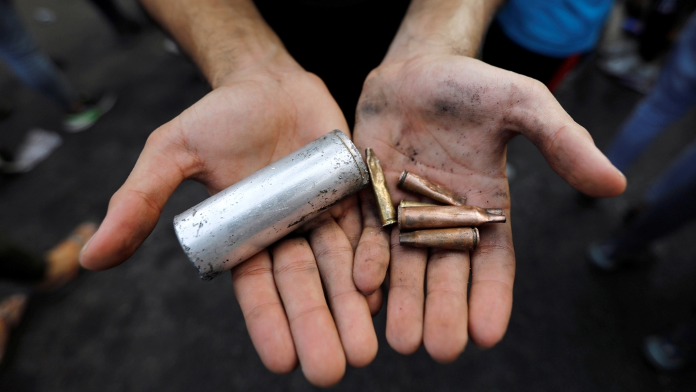 A demonstrator shows empty canisters that were used by Iraqi security forces during a protest over unemployment, corruption and poor public services, in Baghdad, Iraq October 2, 2019.