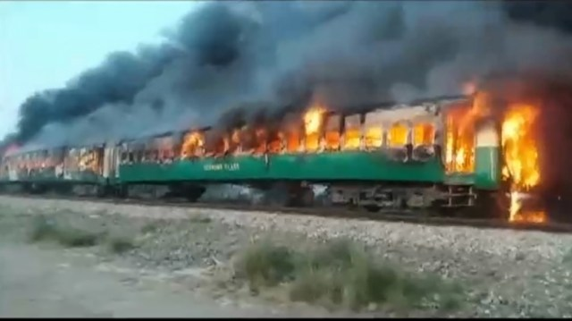 A fire burns a train carriage after a gas canister passengers were using to cook breakfast exploded, near the town of Rahim Yar Khan in the south of Punjab province, Pakistan October 31, 2019, in this