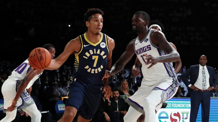 Basketball - NBA Preseason Friendly - Indiana Pacers v Sacramento Kings - NSCI Dome, Mumbai, India - October 4, 2019 Malcolm Brogdon of Indiana Pacers in action with Dewayne Dedmon R of Sacramento Kings