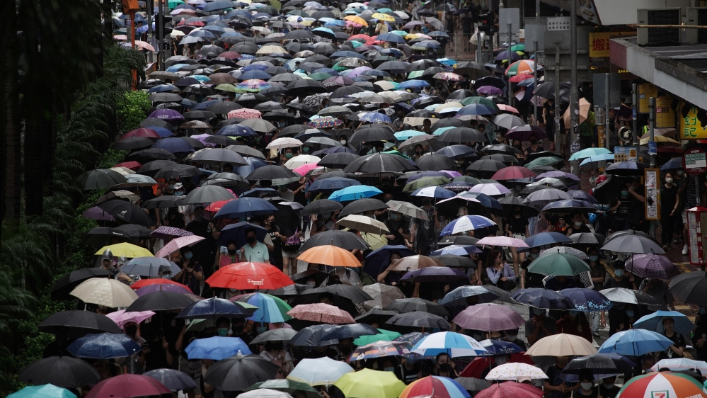 Anti-government protesters attend a demonstration in Wan Chai district, in Hong Kong
