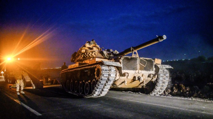 A Turkish army's tank drives towards the border with Syria near Akcakale in Sanliurfa province on October 8, 2019. Turkey said on October 8, 2019, it was ready for an offensive into northern Syria, w