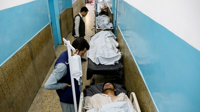 Injured men receive treatment in the hospital after sustaining wounds from a blast at a wedding hall in Kabul, Afghanistan August 18, 2019. REUTERS/Mohammad Ismail