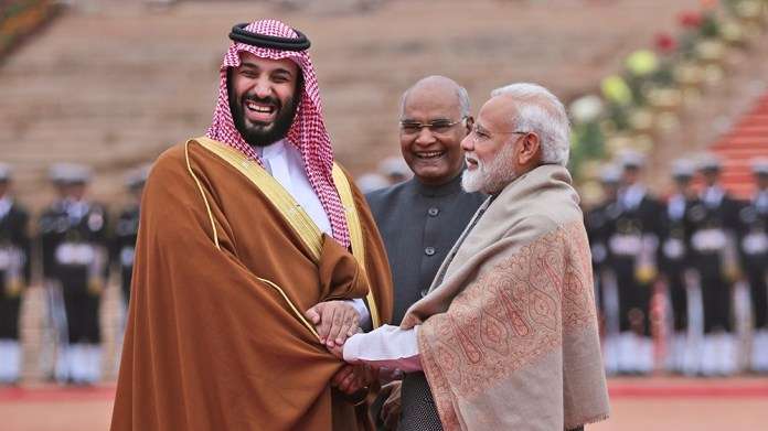 FILE - In this Feb. 20, 2019 file photo, Saudi Arabia's Crown Prince Mohammed bin Salman shakes hand with Indian Prime Minister Narendra Modi during a ceremonial welcome in New Delhi, India. Amid the