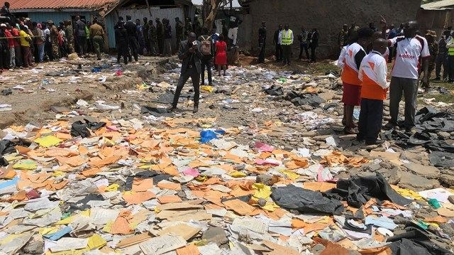 Emergency workers at the site where a school building collapsed, in Nairobi, Kenya, 23 September 2019. According to reports, at least seven primary school children were killed when a classroom structu